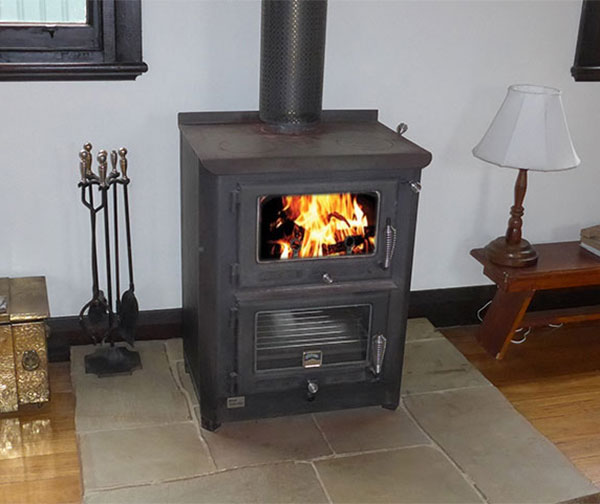 Wood stove supplements gas ducted heating